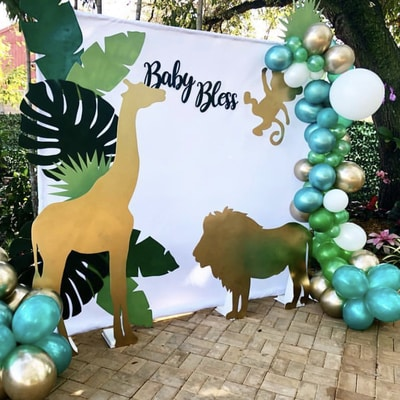 Baby shower booth with a giraffe lion to go with a safari theme
