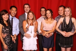 Four couples pair up for a picture at a formal dance party