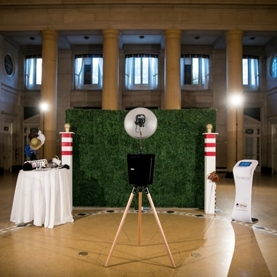 A professional open air photo booth that allows people to take pictures in front of. Perfect for corporate events